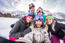 Group Of Snowboarders On Winte...