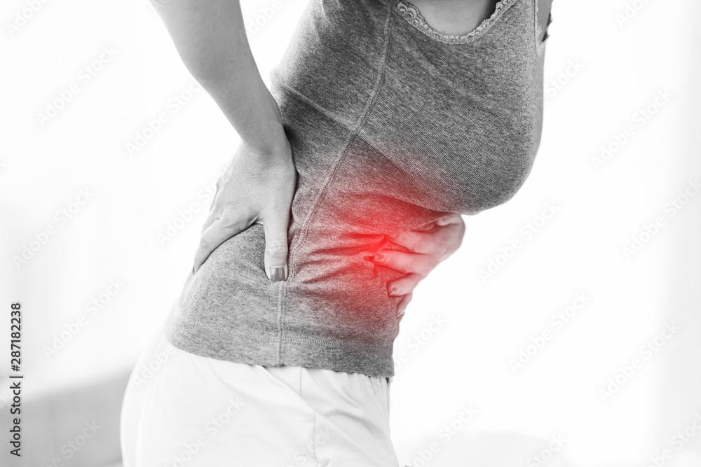 Fototapeta Adult woman feeling unewll suffering from menstruation pain