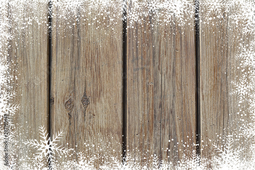 Fotomural  Christmas winter background with snowflakes on wood