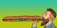 Man Eats A Long Sandwich