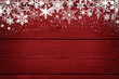 canvas print picture - Red Christmas winter background with snowflakes on wood