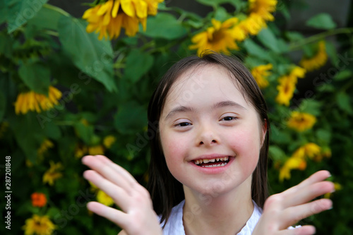 Fotografie, Obraz  Portrait of little girl smiling in the garden