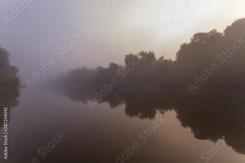 Fotografija  Sunrise with a fog in the cristalino's river, Amazon Rainforest - Mato Grosso, B