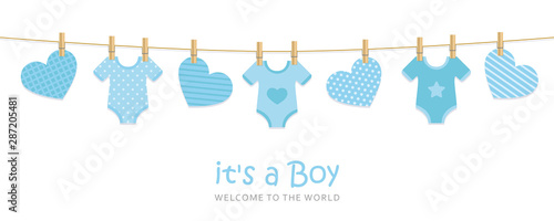 Fotografía  its a boy welcome greeting card for childbirth with hanging hearts and bodysuits