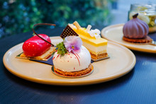 Close -up Of Beautifully Designed Cakes And Pastries