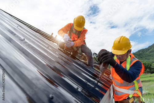 Fototapeta Technician is Work Roof Repair Construction engineer wear safety uniform inspection metal roofing work for roof obraz
