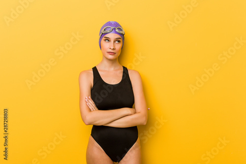 Young swimmer caucasian woman tired of a repetitive task. Canvas Print