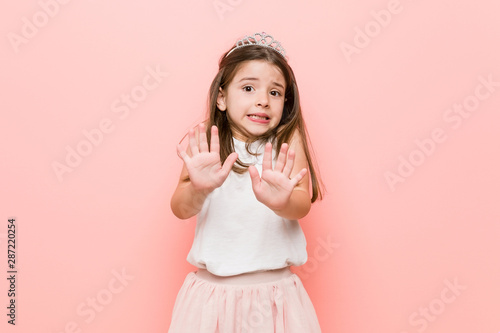 Fotografie, Tablou  Little girl wearing a princess look rejecting someone showing a gesture of disgust