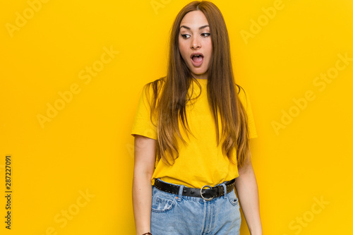 Young ginger redhead woman being shocked because of something she has seen Tapéta, Fotótapéta