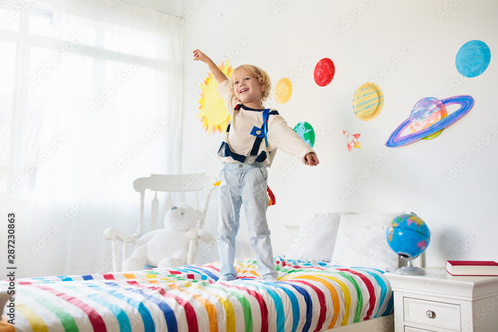 Fototapeta Kids play astronaut. Space and planet child game.