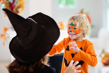 Child In Halloween Costume. Ki...