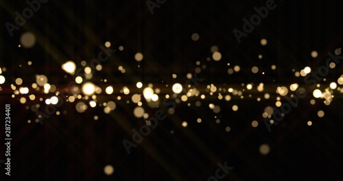 Obraz Abstract light bokeh sparks, bright glitter particles or dust shine blur bling. Shiny bright snow effect, shimmering light and magic glow sparkles, Christmas luxury background - fototapety do salonu