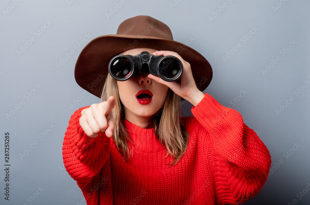 Fototapety, obrazy: woman in red sweater and hat with binocular
