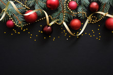 Christmas Dark Black Background With Red Baubles, Christmas Decorations, Fir Tree Branches, Confetti Star. Xmas Frame Border, Top View, Copy Space. Greeting Card Mockup.