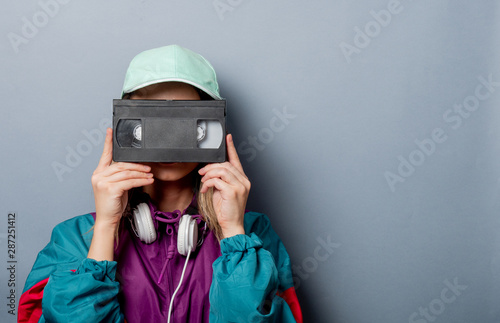 Valokuvatapetti Style woman in 90s clothes style with VHS video cassette