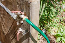 Garden Hose With Faucet In Bot...