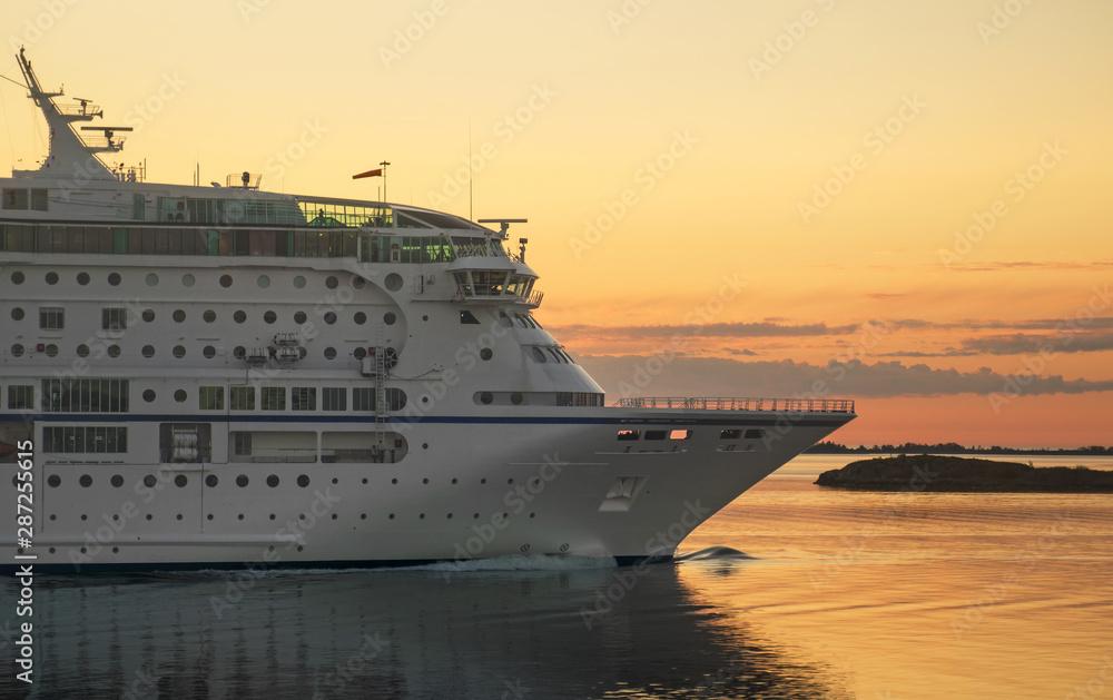 Fototapeta Passenger ferry against a sunset in the Baltic sea.