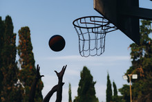 Street Basketball Game. Shield, Ball Flies To The Basket. Accurate Throw In Basketball Ring. Concept Of Sport.
