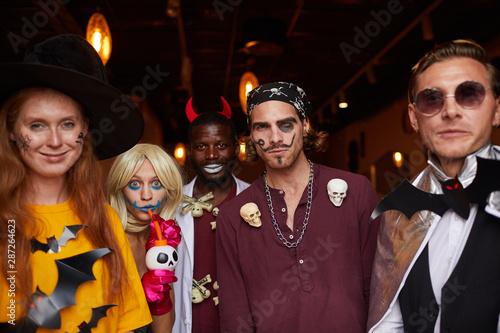 Multi-ethnic group of people wearing Halloween costumes posing looking at camera Fototapeta