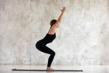 Beautiful Woman Practicing Yoga, Chair Exercise, Utkatasana Pose