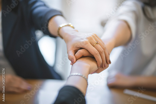 Top view of business people put hands together Fototapet