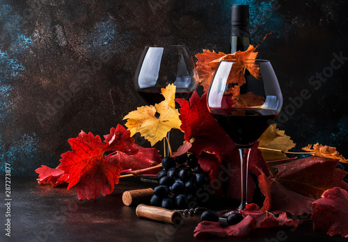 Papiers peints Vin Dry Red Wine in big wine glass, autumn still life with leaves, wine tasting concept, rustic style, selective focus