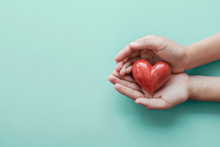 Hands Holding Red Heart, Health Care, Love, Organ Donation, Wellbeing Family Insurance,CSR Concept, World Heart Day, World Health Day, Hope, Gratitude, Covid-19, Coronavirus Relief, Praying Concept