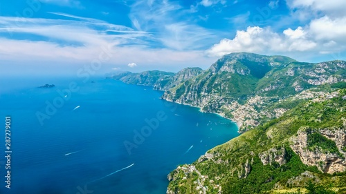 Poster de jardin Europe Méditérranéenne Panorama of the beautiful Amalfi Coast in Italy during summer, with vibrant blue water and sky, taken from the Path of the Gods hiking trail.