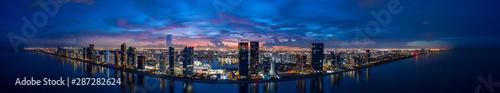 Obraz Aerial Twilight Panorama Miami Dade Sunny Isles Beach FL USA. Beautiful deep saturated vibrant colors blue and purple - fototapety do salonu
