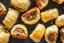 Mini Cocktail Sausage Rolls On Baking Tin Out Of Oven