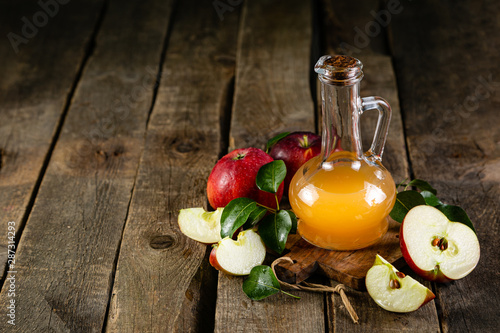 fototapeta na drzwi i meble Apple cider in glass jar, wood background