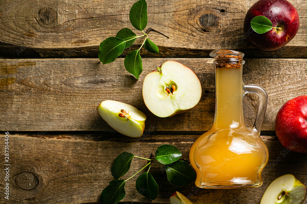 Fototapety, obrazy: Apple cider in glass jar, wood background