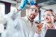 Leinwanddruck Bild Scientists in the lab obtaining experimental data