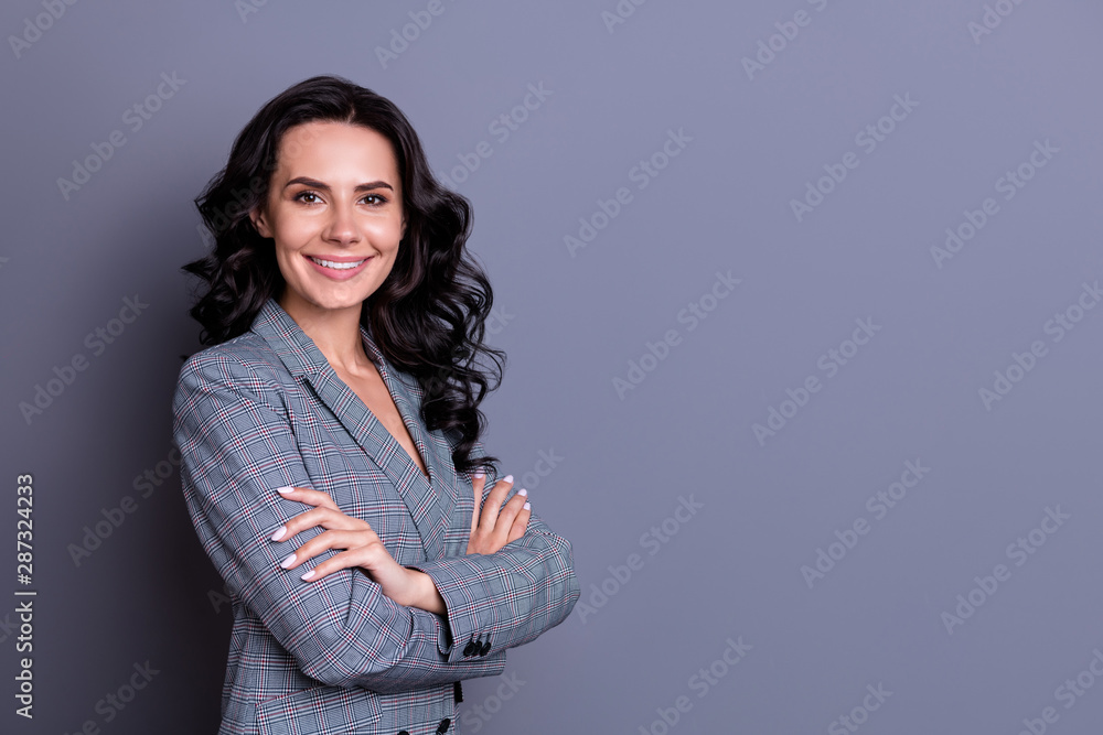 Fototapeta Turned photo of cheerful woman looking with her hands crossed wearing trendy blazer jacket isolated over greay background