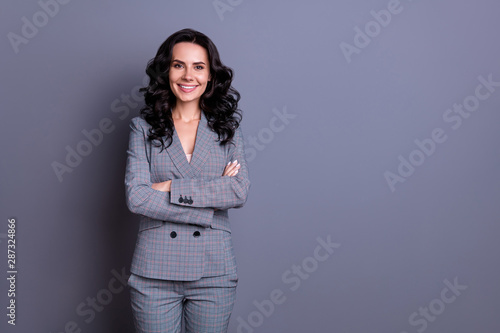 Fototapety, obrazy: Portrait of beautiful woman crossing her hands wearing pants trousers isolated over gray background