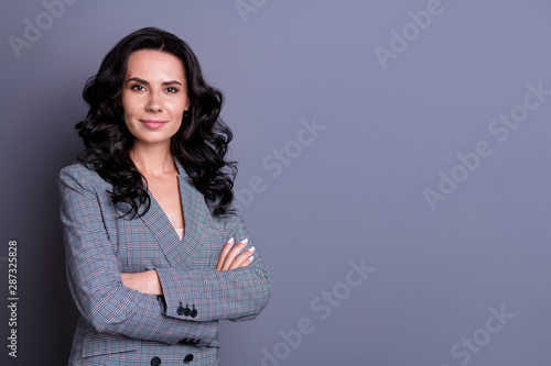 Fototapety, obrazy: Turned photo of stylish woman crossing her hands looking wearing suit blazer isolated over gray background