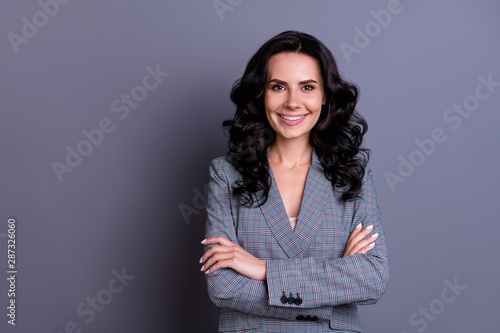 Fototapety, obrazy: Portrait of beautiful successful freelancer with curly hairstyle crossing her hands wearing blazer isolated over gray background