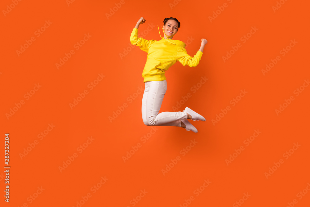 Fototapety, obrazy: Full body photo of lovely teen raising fists smiling isolated over orange background