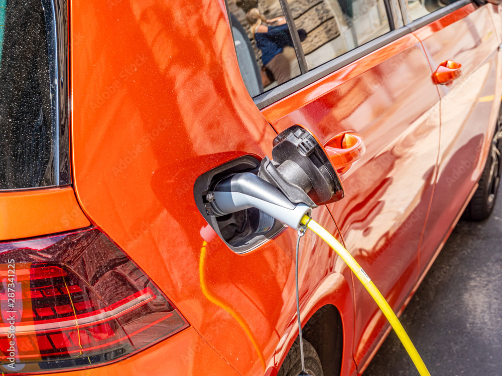 Fototapeta Elektroauto Ladestation Umweltschutz Klimawandel Co2