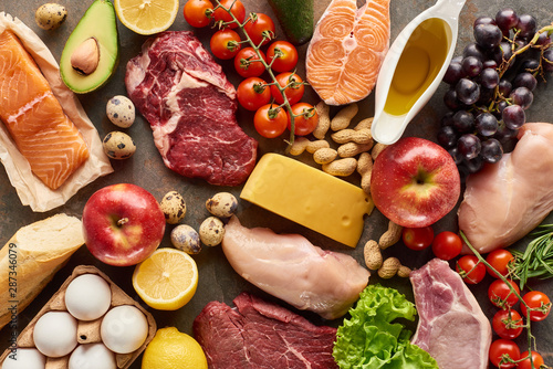 Door stickers Buffet, Bar Top view of assorted meat, poultry, fish, eggs, fruits, vegetables, cheese, olive oil and baguette