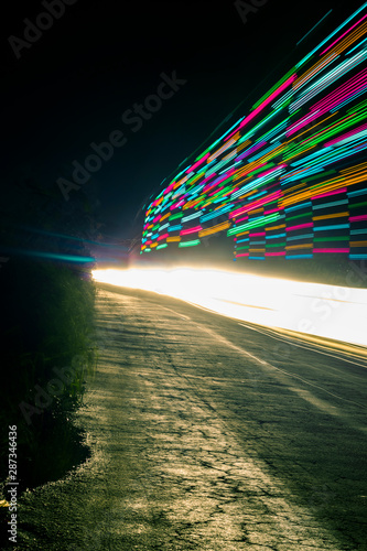 A long exposure photograph of vehicles moving through the country side India, A shot from Kerala Canvas Print