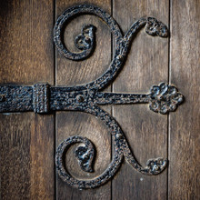 Wrought Iron Hinge Detail On Old Timber Church Doors.