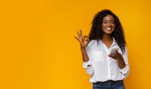 Cute Black Lady Showing Her Satisfaction With New Cellphone