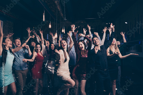 Portrait of cute millennial buddies fellows raise hands scream shout beautiful feel rejoice content arms formalwear formal wear dress suit charming indoors - 287360882