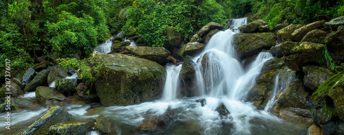 Panoramic beautiful deep forest waterfall in Thailand - 287376017