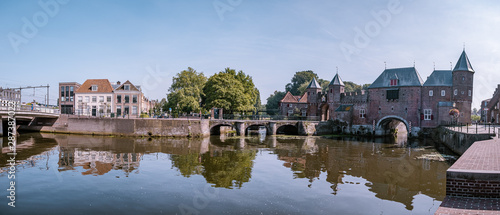 Dutch city during summer, Medieval town wall Koppelpoort and the Eem river in Am Wallpaper Mural