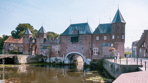 Dutch city during summer, Medieval town wall Koppelpoort and the Eem river in Am Canvas Print