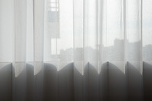 White Transparent Curtain At Glass Window With Light And Shadow. Lace Curtain.