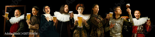 Photo Young people as a medieval grandee on dark studio background