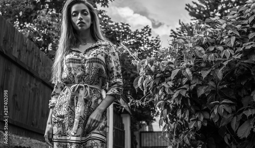Poster Artist KB Beautiful emotional black-white portrait of young woman outdoor.